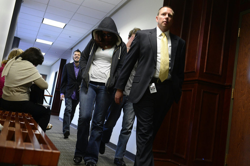 . People exit the courtroom for a break during a hearing for James Holmes, the accused gunman in the Aurora theater shooting, at the Arapahoe County Justice Center on Monday, January 7, 2013. AAron Ontiveroz/The Denver Post