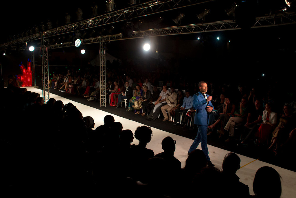 . A model wears a design by menswear designer Lamine Diasse, of Senegal, during the final runway show of Dakar Fashion Week, at Hotel des Almadies, in Dakar, Senegal, in the early morning hours of Sunday, June 23, 2013. After a Friday runway show held in a dusty marketplace in the working class suburb of Guediawaye, Dakar Fashion Week closed Saturday night with a finale at a luxury hotel that showcased the work of 14 designers from West Africa, Europe, South America, and the Caribbean. (AP Photo/Rebecca Blackwell)
