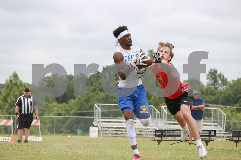 Jacksonville #3 reciever Jaeshun Bush makes a great catch with defender on him at lindsay park Saturday June 17, 2017