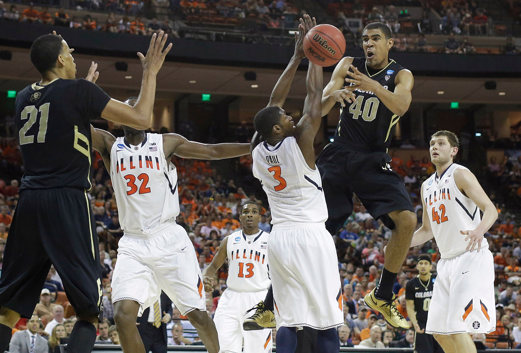 . Colorado\'s Josh Scott (40) passes the ball around Illinois\' Brandon Paul (3) during the second half of a second-round game of the NCAA college basketball tournament on Friday, March 22, 2013, in Austin, Texas. Illinois defeated Colorado 57-49. (AP Photo/Eric Gay)