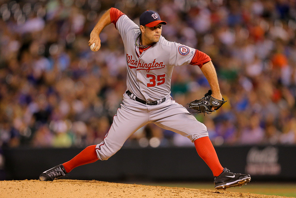 . DENVER, CO - JULY 22: Relief pitcher Craig Stammen #35 of the Washington Nationals delivers to home plate during the sixth inning against the Colorado Rockies at Coors Field on July 22, 2014 in Denver, Colorado.  (Photo by Justin Edmonds/Getty Images)