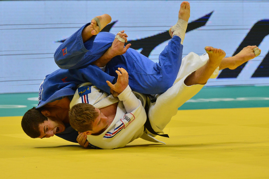 . France\'s Loic Pietri (white) competes with Georgia\'s Avtandili Tchrikishvili during the 81kg category final of the IJF World Judo Championship in Rio de Janeiro, Brazil, on August 29, 2013.  YASUYOSHI CHIBA/AFP/Getty Images