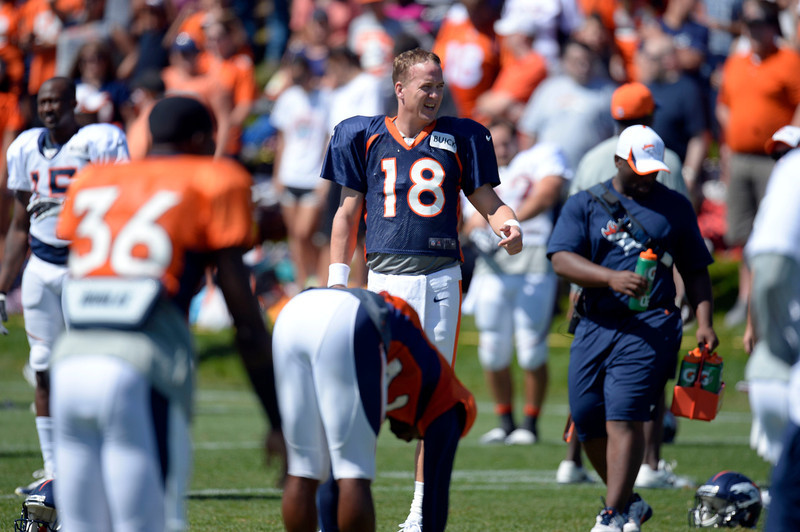 . Denver Broncos QB Peyton Manning (18) prepares for stretching during training camp August 12, 2013 at Dove Valley. (Photo By John Leyba/The Denver Post)