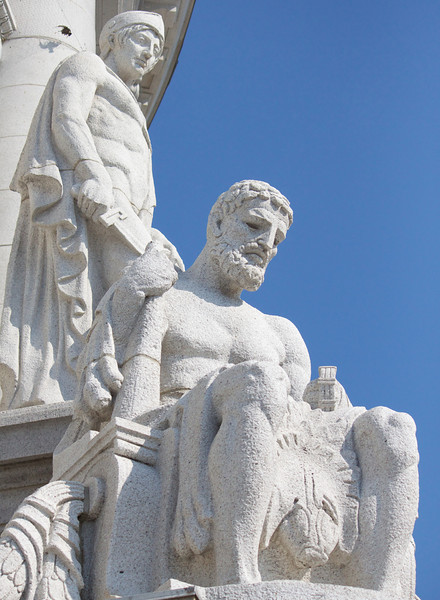statues at the base of the capitol dome
