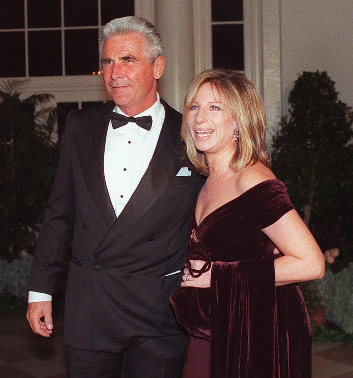 . This file photo shows Barbra Streisand (R) and James Brolin arriving at the White House 05 February for a state dinner in honor of British Prime Minister Tony Blair and his wife Cherie.   (CHRIS KLEPONIS/AFP/Getty Images)
