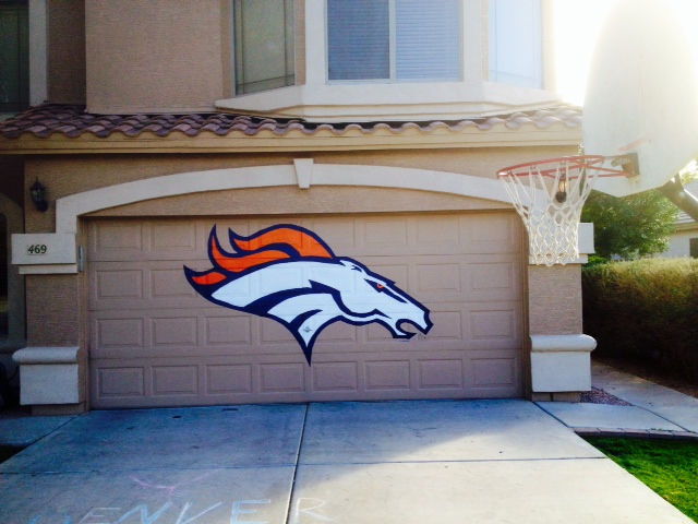 . My name is Jeff and me and my two sons and my daughter painted this Denver Broncos logo on our garage in Phoenix Arizona and thought you guys might enjoy it.