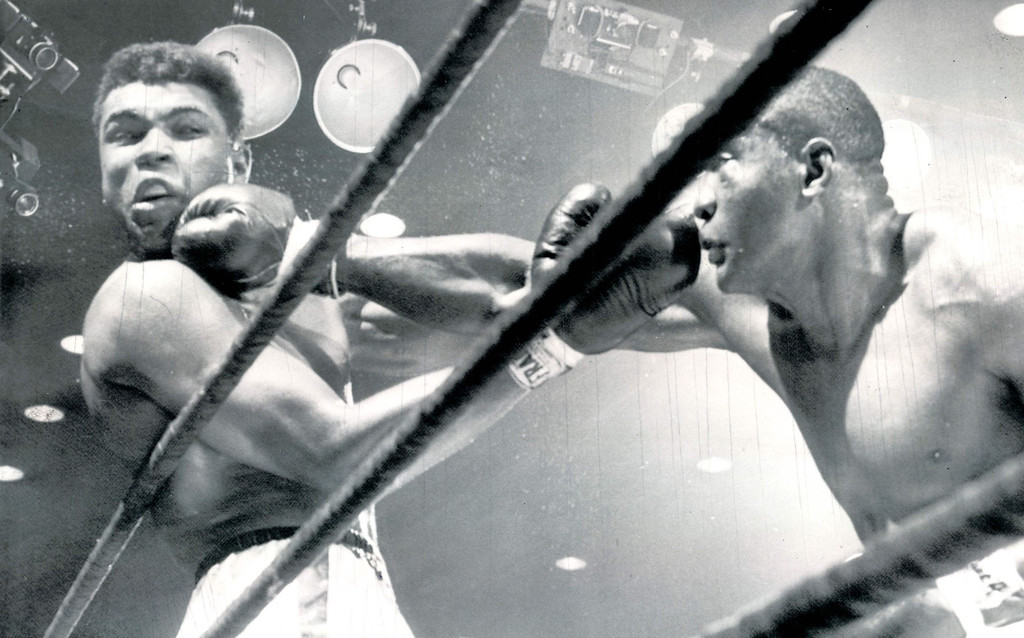 . It wasn\'t all Clay, though, despite the fact he claimed the title in one of boxing\'s biggest upsets.  Clay took his share of punches as shown in this fifth-round action as a right hand smash by Liston turns his head.  Liston had decided edge in round.  1964. Denver post Library Archive