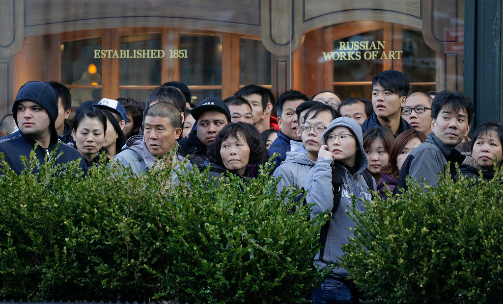 . Several hundred people stand in line waiting to enter the Apple store to buy the newly released iPhone 6 and iPhone 6 Plus, Friday, Sept. 19, 2014,  in New York. The highly anticipated iPhone 6 and iPhone 6 Plus are being released in stores today. (AP Photo/Julie Jacobson)