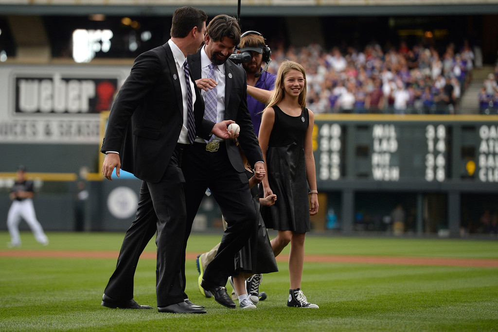 . Colorado Rockies great Todd Helton walks off the field ith his daughters, Tierney Faith (right) and Gentry Grace, with former teammate, Brad Hawpe, during a retirement ceremony for his number 17. Helton, who played 17 season with the Rockies and holds records for many of the organizations career statistics, was honored on Sunday, August 17, 2014. (Photo by AAron Ontiveroz/The Denver Post)