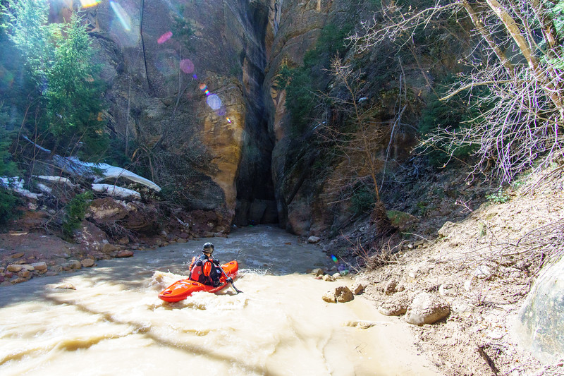 Eric Jones floats towards an ominous narrows early on the North Fork of the Virgin above Zion National Park.
