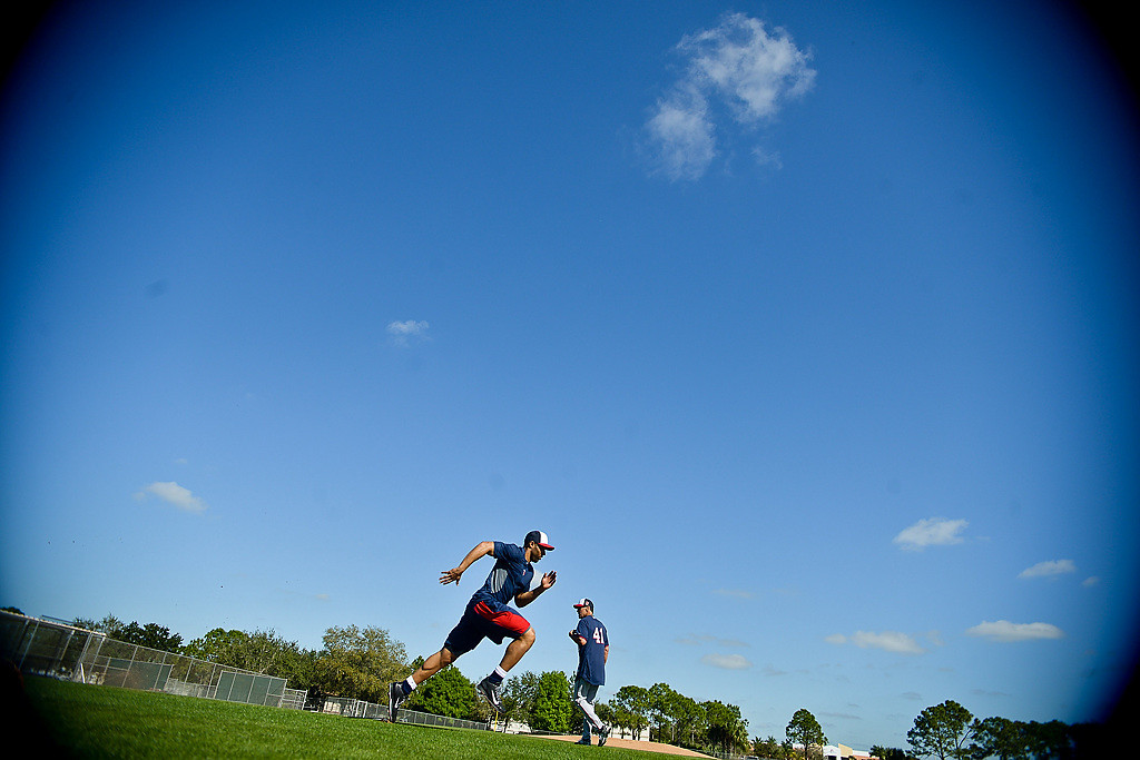 . Under blue skies with temps reaching 80 degrees, players run drills at the Lee County Sports Complex. (Pioneer Press: Ben Garvin)