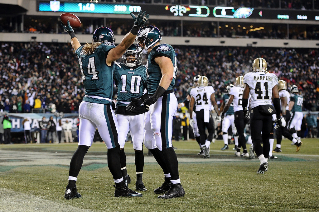 . PHILADELPHIA, PA - JANUARY 04:  Riley Cooper #14 of the Philadelphia Eagles celebrates with his teammates  DeSean Jackson #10 and  Brent Celek #87 after scoing a 10 yard touchdown thrown by Nick Foles #9 in the second quarter against the New Orleans Saints during their NFC Wild Card Playoff game at Lincoln Financial Field on January 4, 2014 in Philadelphia, Pennsylvania.during their NFC Wild Card Playoff game at Lincoln Financial Field on January 4, 2014 in Philadelphia, Pennsylvania.  (Photo by Maddie Meyer/Getty Images)
