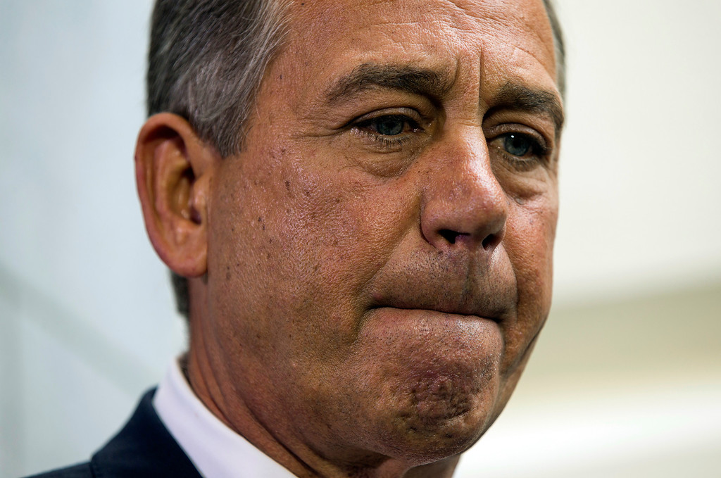 . Speaker of the House John Boehner, R- Ohio, pauses during a news conference after a House Republican Conference meeting about the ongoing budget fight on Capitol Hill on Monday, Sept. 30, 2013 in Washington.  (AP Photo/ Evan Vucci)