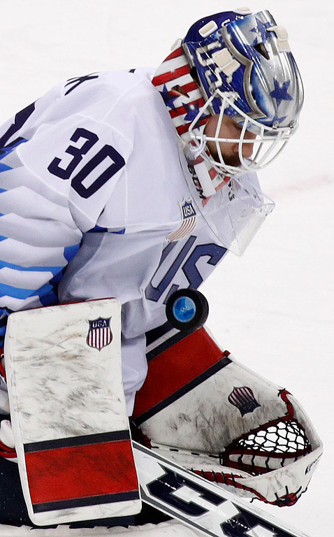 . goalie Ryan Zapolski (30), of the United States, deflects the puck during the XXX period of the quarterfinal round of the men\'s hockey game against the Czech Republic at the 2018 Winter Olympics in Gangneung, South Korea, Wednesday, Feb. 21, 2018. (AP Photo/Jae C. Hong)