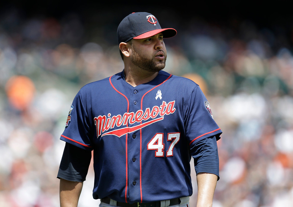. Minnesota Twins pitcher Ricky Nolasco walks to the dugout after being relieved in the sixth inning of a baseball game against the Detroit Tigers in Detroit, Sunday, June 15, 2014. (AP Photo/Paul Sancya)