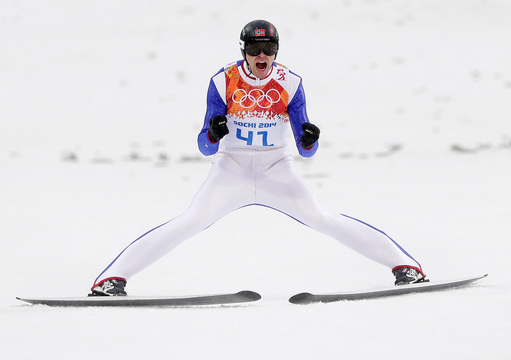 . Norway\'s Magnus Hovdal Moan celebrates after his jump during the Nordic combined individual Gundersen large hill competition at the 2014 Winter Olympics, Tuesday, Feb. 18, 2014, in Krasnaya Polyana, Russia. (AP Photo/Matthias Schrader)