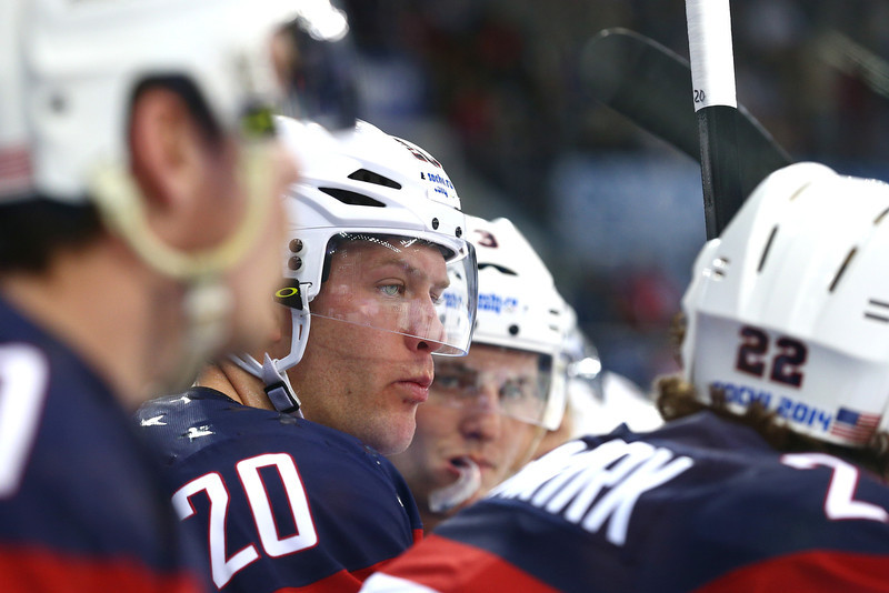 . Ryan Suter #20 of the United States looks on from the bench during the Men\'s Ice Hockey Quarterfinal Playoff on Day 12 of the 2014 Sochi Winter Olympics at Shayba Arena on February 19, 2014 in Sochi, Russia.  (Photo by Clive Mason/Getty Images)