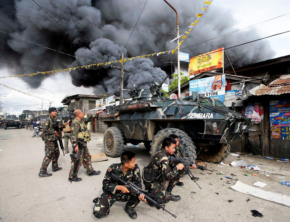 . Government troopers continue their assault on Muslim rebels Thursday, Sept. 12, 2013, at Zamboanga city in the southern Philippines.  Philippine troops battled Muslim rebels on two fronts Thursday, after extremists attacked a second city near the southern port where guerrillas have been holding scores of residents hostage in a four-day standoff with government forces. (AP Photo/Bullit Marquez, File)