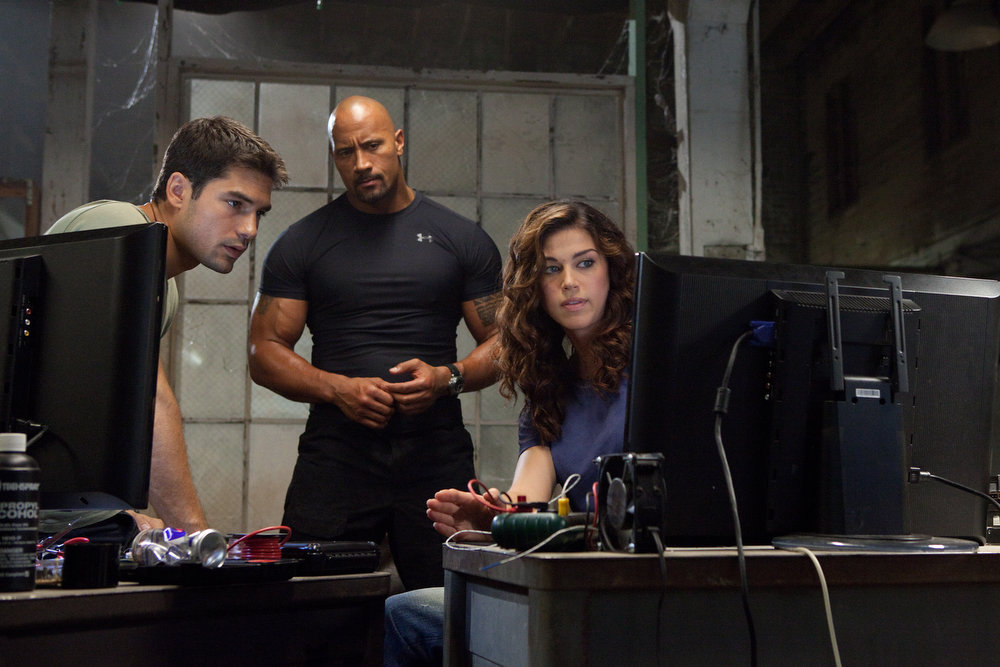 Description of . Left to right: D.J. Cotrona plays Flint, Dwayne Johnson plays Roadblock, and Adrianne Palicki plays Lady Jaye in G.I. JOE: RETALIATION, from Paramount Pictures, MGM, and Skydance Productions. (Jaimie Trueblood/Paramount Pictures)