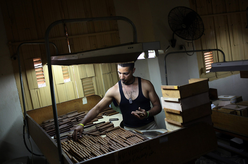 . A man works at La Corona cigars factory in Havana, Cuba, 27 February 2014. Participants in the XVI Habano Festival visited the factory as part of the festival activities before it\'s final day on 28 February 2014.  (EPA/Alejandro Ernesto)