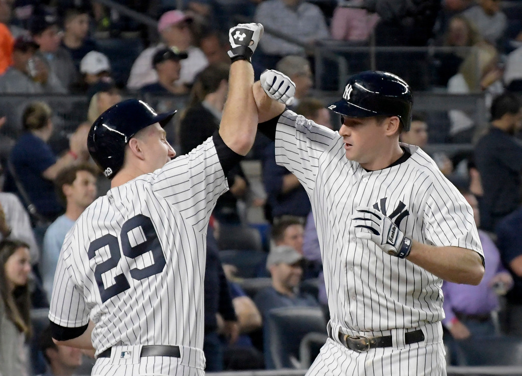 . New York Yankees\' Chase Headley, right, celebrates with Todd Frazier after Headley hit a home run during the third inning of a baseball game against the Cleveland Indians, Monday, Aug. 28, 2017, at Yankee Stadium in New York. (AP Photo/Bill Kostroun)