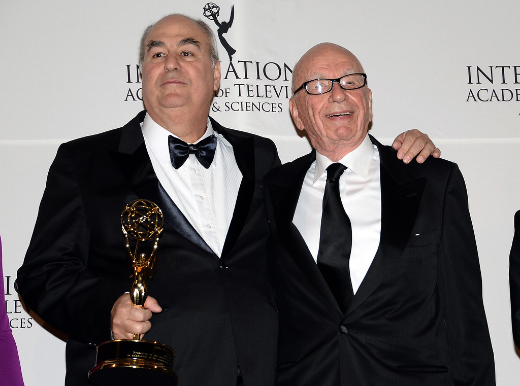 . TV Globo Chairman and CEO Roberto Irineu Marinho, left, poses with the Directorate Award and special presenter Rupert Murdoch in the International Emmy Awards gala press room at the New York Hilton on Monday, Nov. 24, 2014, in New York. (Photo by Evan Agostini/Invision/AP)