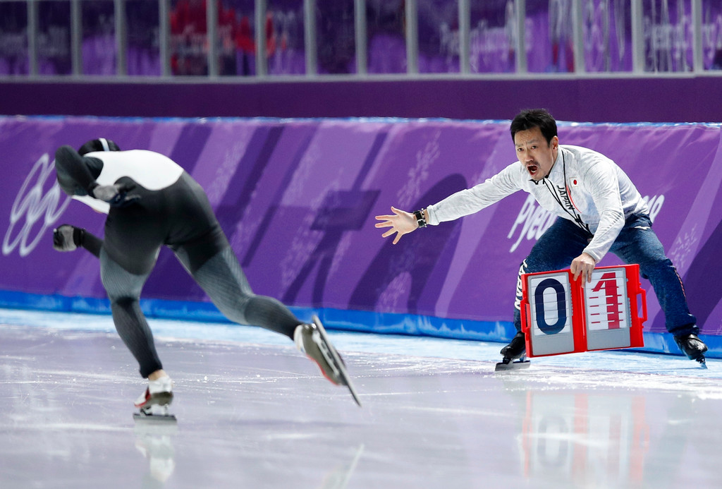 . Japan\'s Seitaro Ichinohe\'s coach, right, encourages him as he competes during the men\'s 5,000 meters race at the Gangneung Oval at the 2018 Winter Olympics in Gangneung, South Korea, Sunday, Feb. 11, 2018. (AP Photo/Vadim Ghirda)