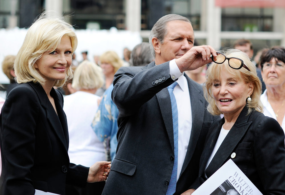 . Diane Sawyer, left, smiles as Charles Gibson, center, fiddles with Barbara Walter\'s glasses as they leave the memorial ceremony for Walter Cronkite, Wednesday Sept. 9, 2009 at Avery Fisher Hall in New York. (AP Photo/Stephen Chernin)