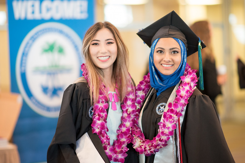 Hannah Moses (left), and Noori Zubair. Over 1,100 graduates received their degrees during two commencement ceremonies held on May 13.