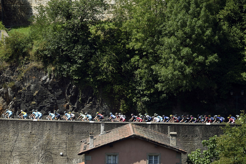 . The pack rides during the 197.5 km thirteenth stage of the 101st edition of the Tour de France cycling race on July 18, 2014 between Saint-Etienne and Chamrousse, central eastern France.  (ERIC FEFERBERG/AFP/Getty Images)