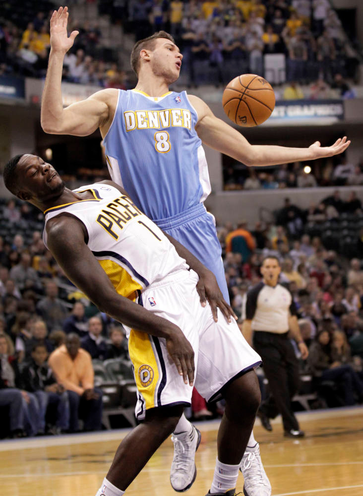 . Denver Nuggets forward Danilo Gallinari, right, of Italy, loses the ball after dribbling into Indiana Pacers guard Lance Stephenson during the first half of an NBA basketball game in Indianapolis, Friday, Dec. 7, 2012. (AP Photo/AJ Mast)