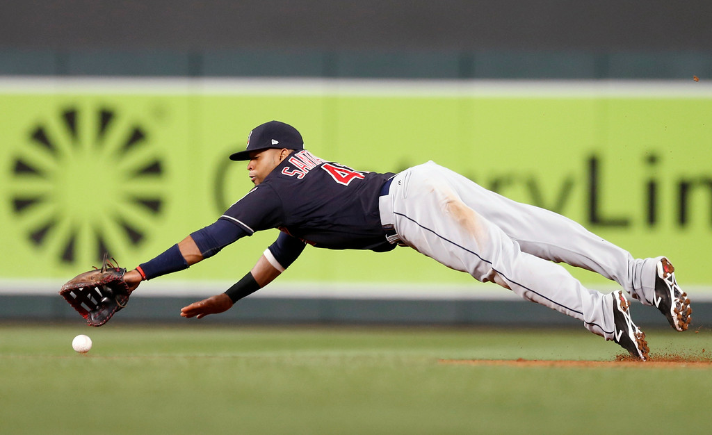 . Cleveland Indians\' Carlos Santana dives for a sharp grounder by Minnesota Twins\' Jason Castro on a fielder\'s choice in the eighth inning of a baseball game, Monday, April 17, 2017, in Minneapolis. The Indians won 3-1. (AP Photo/Jim Mone)