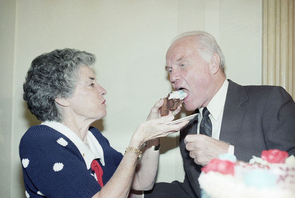 . Sen. John Glenn, D-Ohio, right, gets a taste of birthday cake from his wife Annie Glenn during a surprise birthday party in his honor on Capitol Hill, Thursday, July 17, 1986, Washington, D.C. Glenn will be 65-years-old on Friday. (AP Photo/Lana Harris)