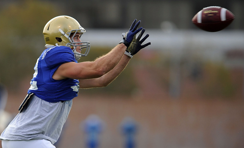 . UCLA\'s Sam Handler catches a pass during practice April 9, 2014 in Westwood, CA.(Andy Holzman/Los Angeles Daily News)