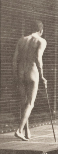 Nude man walking with cane