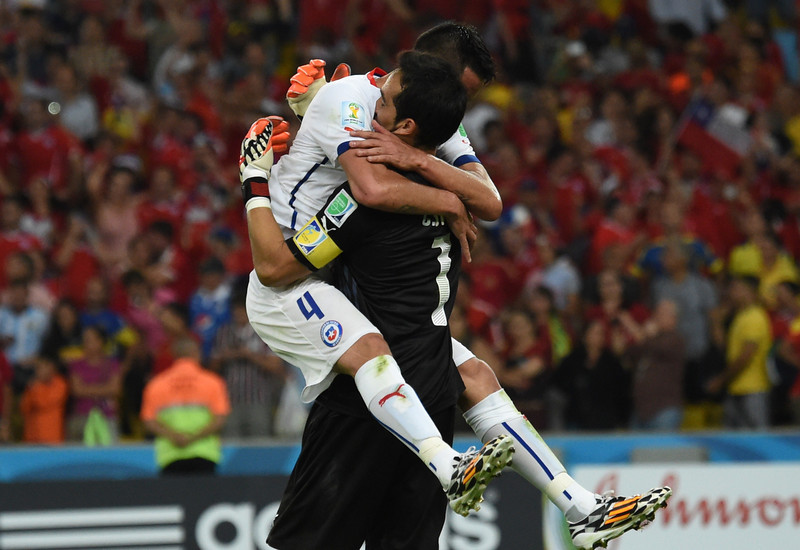 . Chile\'s defender Mauricio Isla (L) and Chile\'s goalkeeper and captain Claudio Bravo react after a Group B football match between Spain and Chile in the Maracana Stadium in Rio de Janeiro during the 2014 FIFA World Cup on June 18, 2014.  (CHRISTOPHE SIMON/AFP/Getty Images)