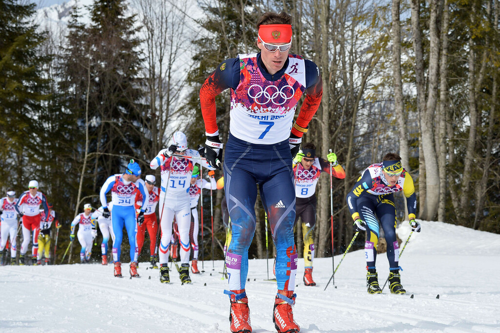 . Russia\'s Maxim Vylegzhanin (C) competes in the Men\'s Cross-Country Skiing 15km + 15km Skiathlon at the Laura Cross-Country Ski and Biathlon Center during the Sochi Winter Olympics on February 9, 2014, in Rosa Khutor.  ALBERTO PIZZOLI/AFP/Getty Images