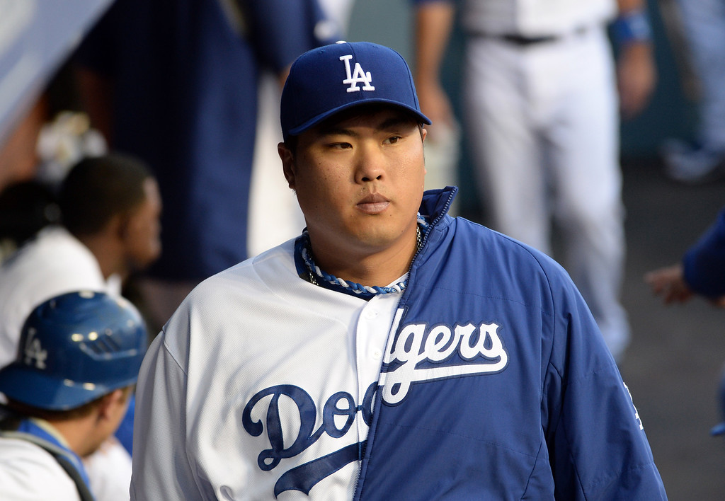 . Los Angeles Dodgers starting pitcher Hyun-Jin Ryu walks in the dugout prior to a baseball game against the Philadelphia Phillies on Tuesday, April 22, 2013 in Los Angeles.   (Keith Birmingham/Pasadena Star-News)