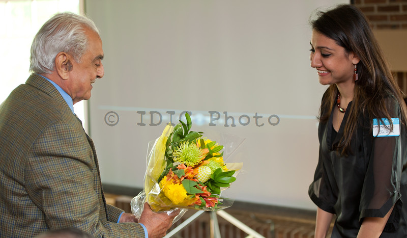 Fatima presenting a bouquet to Syed Babar Ali