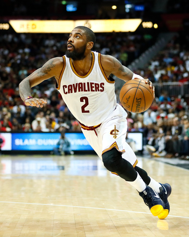 . Cleveland Cavaliers guard Kyrie Irving (2) drives tot he basket in the second half of an NBA basketball game against the Atlanta Hawks on Sunday, April 9, 2017, in Atlanta. The Hawks won in overtime 126-125. (AP Photo/Todd Kirkland)