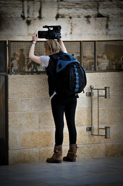 That's a small camera she's using. The big one is in the bag