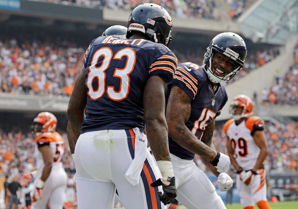 . Chicago Bears tight end Martellus Bennett (83) celebrates his touchdown reception with Brandon Marshall (15) during the first half of an NFL football game against the Cincinnati Bengals, Sunday, Sept. 8, 2013, in Chicago. (AP Photo/Nam Y. Huh)