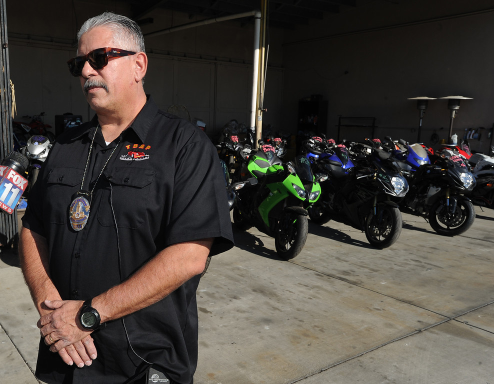 . TRAP team supervisor, Detective Jess Corral stands in front of recovered stolen bikes. The Taskforce for Regional Autotheft Prevention just broke up a high-end theft/chop shop motorcycle ring. The bikes are parked in a tow yard in North Hollywood, CA. 12/20/2013, photo by (John McCoy/Los Angeles Daily News)