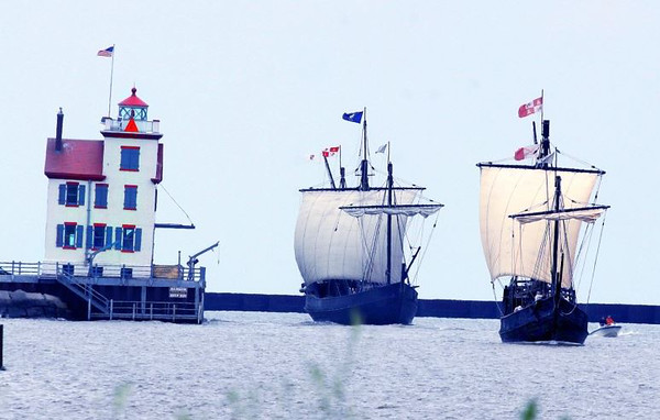. The vessels Nina and Pinta, reproductions of the ships that carried Christopher Columbus and his crew across the Atlantic Ocean, will visit Lorain Aug. 4 to 7, 2017. Here the vessels are shown passing the Lorain Lighthouse in a photograph displayed in the Columbus Foundation\'s official online gallery of the ships at www.thenina.com. (The Columbus Foundation)