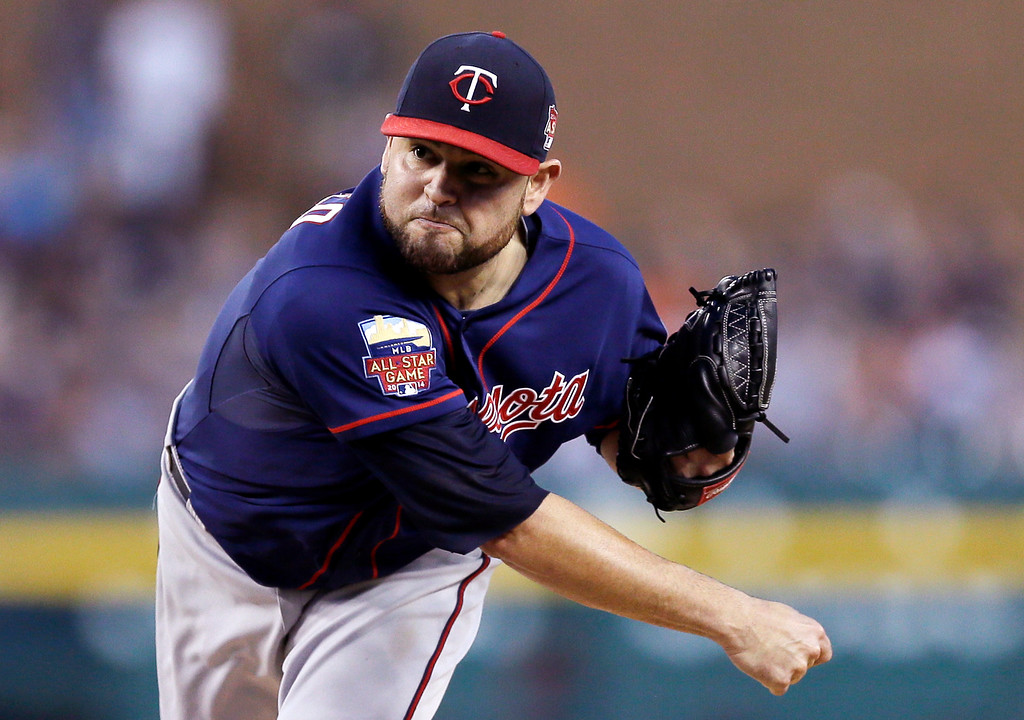 . Minnesota Twins starting pitcher Ricky Nolasco throws during the first inning of a baseball game against the Detroit Tigers in Detroit, Saturday, Sept. 27, 2014. (AP Photo/Carlos Osorio)