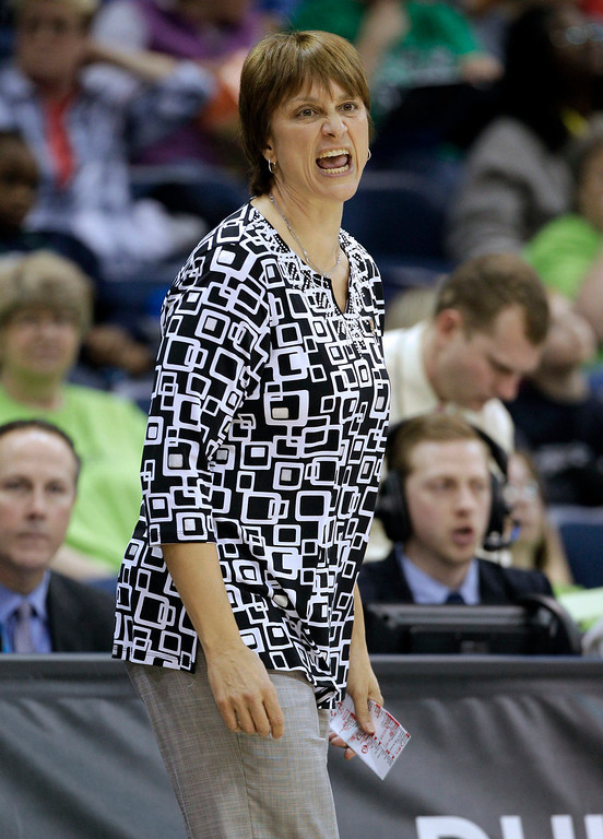 . Nebraska head coach Connie Yori directs her team during a regional semifinal game against Duke of the NCAA college basketball tournament Sunday, March 31, 2013, in Norfolk, Va.  (AP Photo/Steve Helber)