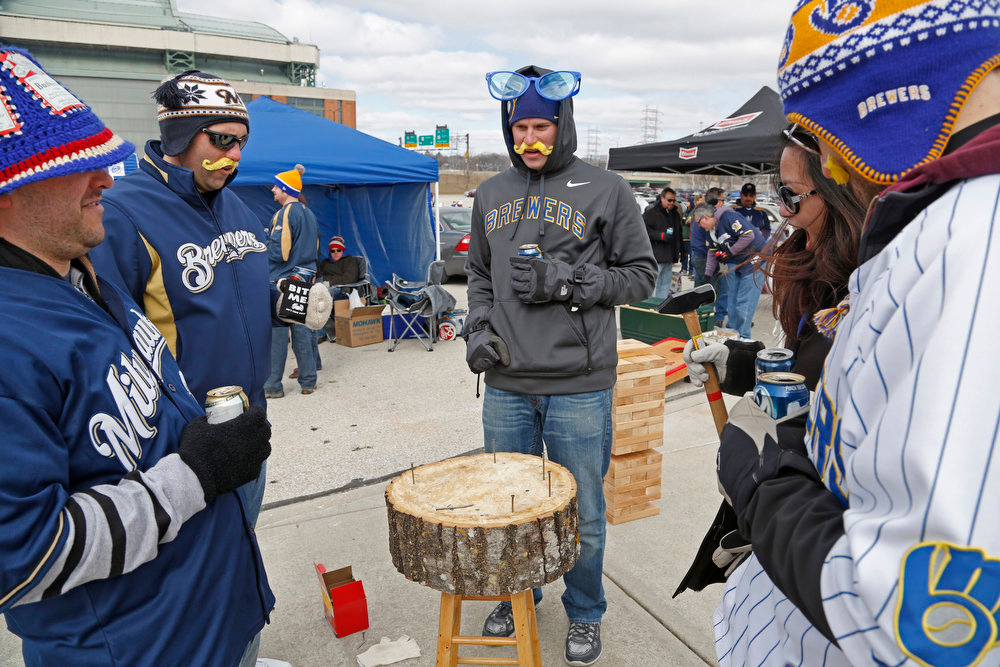 . Fans play a game in the parking lot of Miller Park before the Opening Day baseball game between the Milwaukee Brewers and Colorado Rockies Monday, April 1, 2013, in Milwaukee. (AP Photo/Jeffrey Phelps)