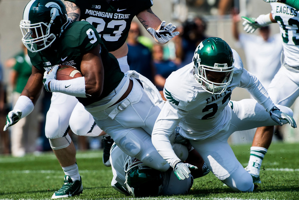 . Michigan State defensive back Montae Nicholson recovers a fumble off of a muffed Eastern Michigan catch on a punt kick during the second quarter on Saturday, Sept. 20, 2014 at Spartan Stadium in East Lansing, Mich. Michigan State won 73-14. (AP Photo/The Flint Journal, Jake May)