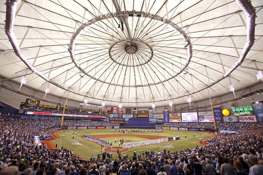 . Baseball fans watch as the Tampa Bay Rays and the Toronto Blue Jays stand for the National Anthem during Opening Day ceremonies at the start of a game on March 31, 2014 at Tropicana Field in St. Petersburg, Florida.  (Photo by Brian Blanco/Getty Images)