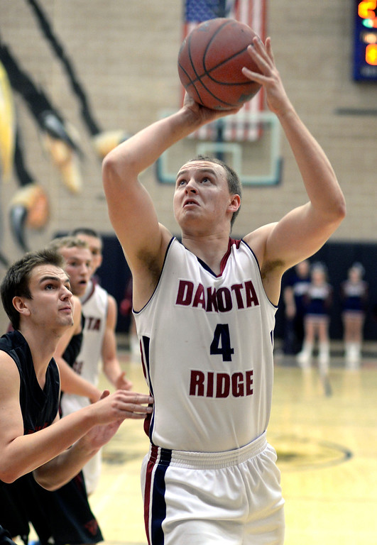 . LITTLETON, CO. - JANUARY 17: Dakota Ridge forward Alden Erickson (4) put up a shot in the first half. The Dakota Ridge High School boy\'s basketball team hosted Chatfield Friday night, January 16, 2014. Photo By Karl Gehring/The Denver Post